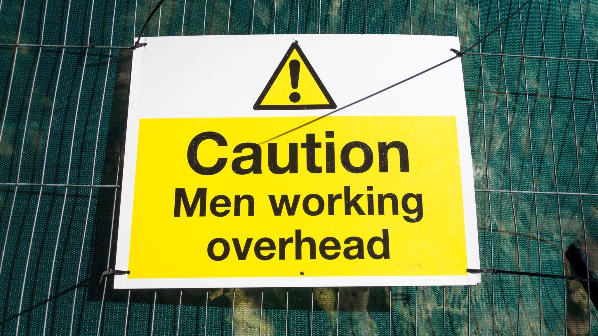 CautionMenWorkingOverhead